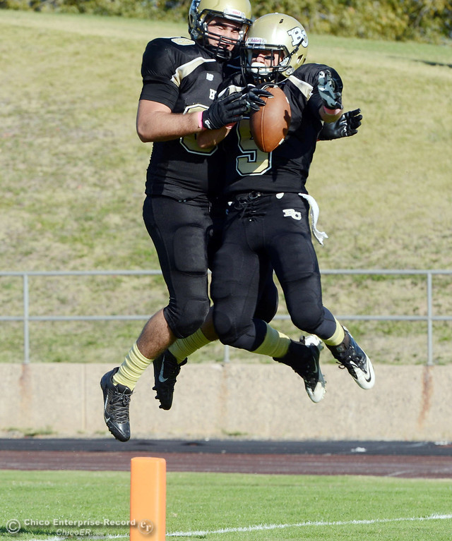 Description of . Butte College's #88 Ralph Raetz (left) and #5 David Brannon (right) leap to celebrate Brannon's touchdown against De Anza College in the third quarter of their football game at Butte's Cowan Stadium Saturday, October 26, 2013 in Oroville, Calif.  (Jason Halley/Chico Enterprise-Record)