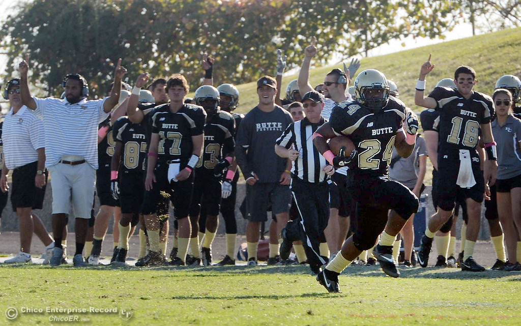 Description of . Butte College's #24 Kendall Williams rushes for a touchdown against De Anza College in the fourth quarter of their football game at Butte's Cowan Stadium Saturday, October 26, 2013 in Oroville, Calif.  (Jason Halley/Chico Enterprise-Record)