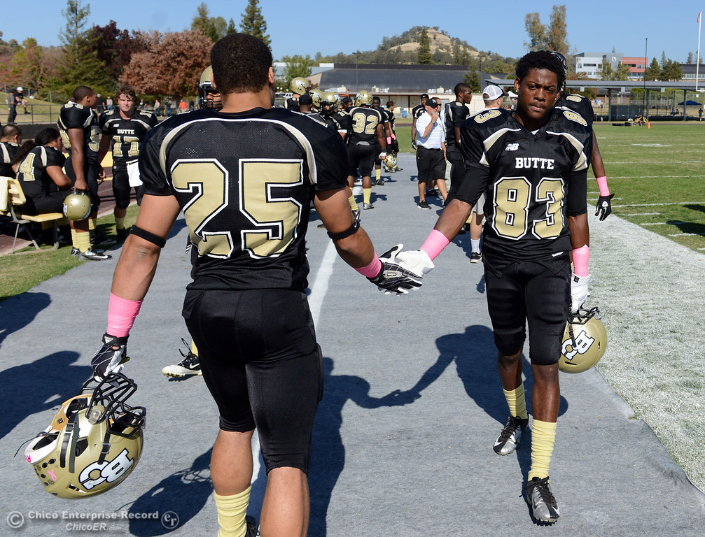 Description of . Butte College's #25 De'Aundray Gooden (left) and #83 Terez Cowam (right) ready against De Anza College in the first quarter of their football game at Butte's Cowan Stadium Saturday, October 26, 2013 in Oroville, Calif.  (Jason Halley/Chico Enterprise-Record)