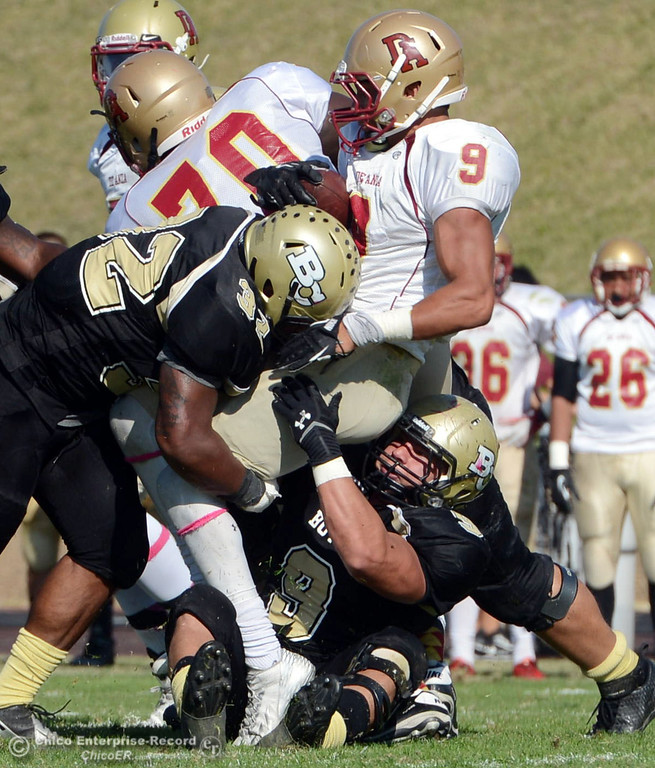 Description of . Butte College's #9 Tyler Adair (right) and #32 Brian Anderson (left) tackle against De Anza College's #9 Justin Arcune (center) in the second quarter of their football game at Butte's Cowan Stadium Saturday, October 26, 2013 in Oroville, Calif.  (Jason Halley/Chico Enterprise-Record)
