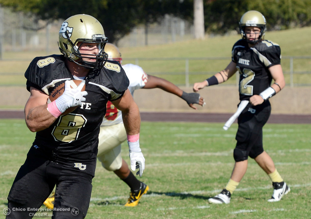 Description of . Butte College\'s #8 Bo Brummel rushes against De Anza College in the second quarter of their football game at Butte\'s Cowan Stadium Saturday, October 26, 2013 in Oroville, Calif.  (Jason Halley/Chico Enterprise-Record)