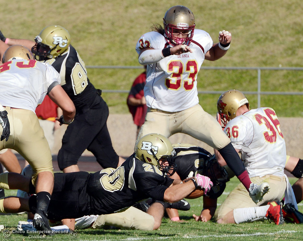 Description of . Butte College's #20 Armand Bokitch (bottom) reaches in for a touchdown against De Anza College in the third quarter of their football game at Butte's Cowan Stadium Saturday, October 26, 2013 in Oroville, Calif.  (Jason Halley/Chico Enterprise-Record)