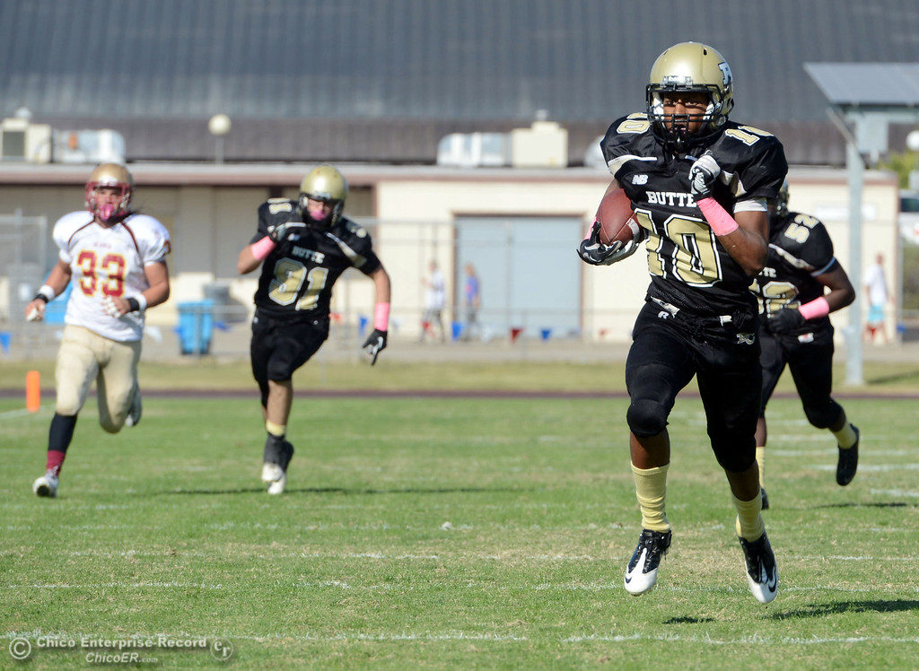 Description of . Butte College\'s #10 CJ Grice carries a kick return for a touchdown against De Anza College in the second quarter of their football game at Butte\'s Cowan Stadium Saturday, October 26, 2013 in Oroville, Calif.  (Jason Halley/Chico Enterprise-Record)