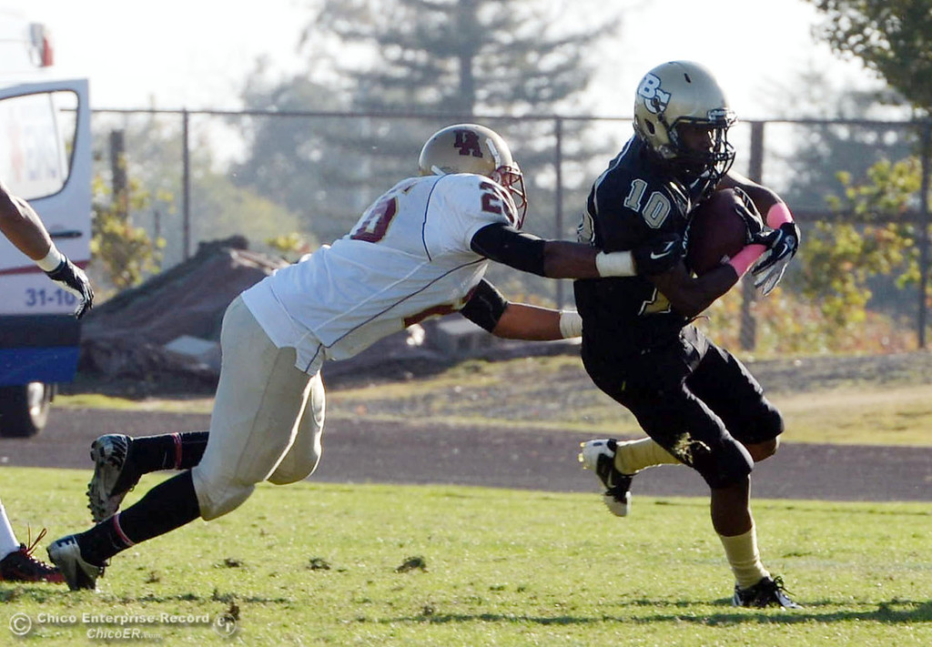 Description of . Butte College\'s #10 CJ Grice (right) rushes against De Anza College\'s #26 Trevor Pardula (left) in the fourth quarter of their football game at Butte\'s Cowan Stadium Saturday, October 26, 2013 in Oroville, Calif.  (Jason Halley/Chico Enterprise-Record)