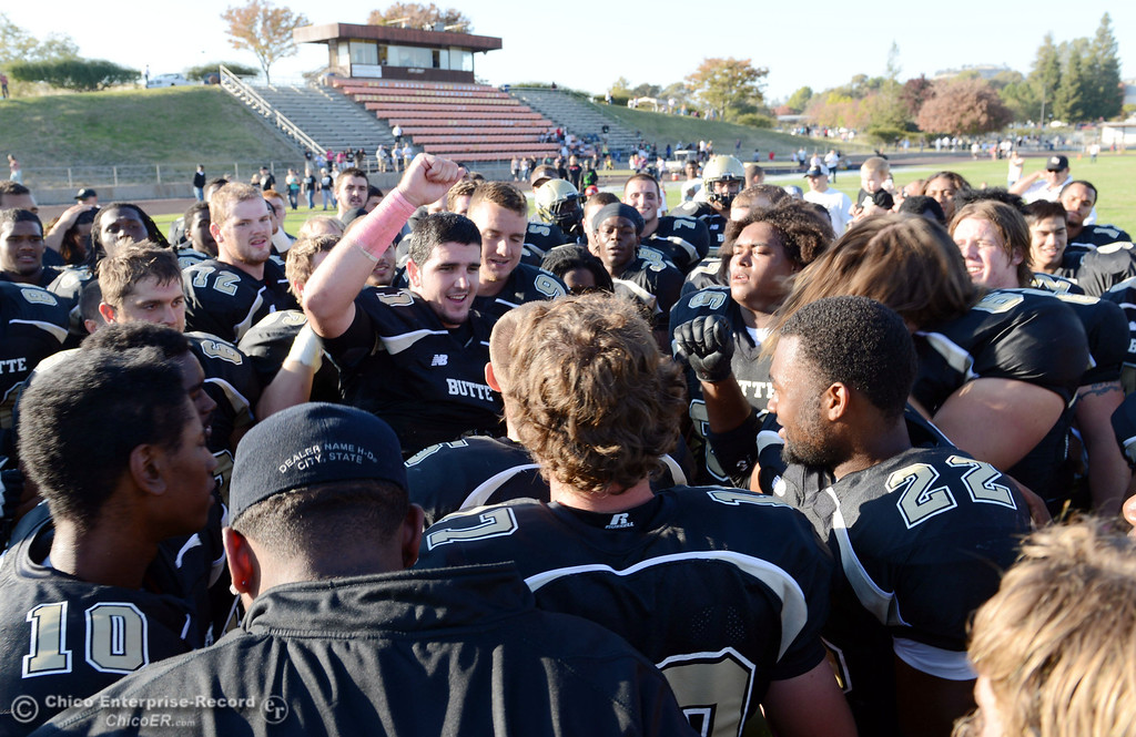 Description of . Butte College's breaks down their win against De Anza College at the end of their football game at Butte's Cowan Stadium Saturday, October 26, 2013 in Oroville, Calif.  (Jason Halley/Chico Enterprise-Record)