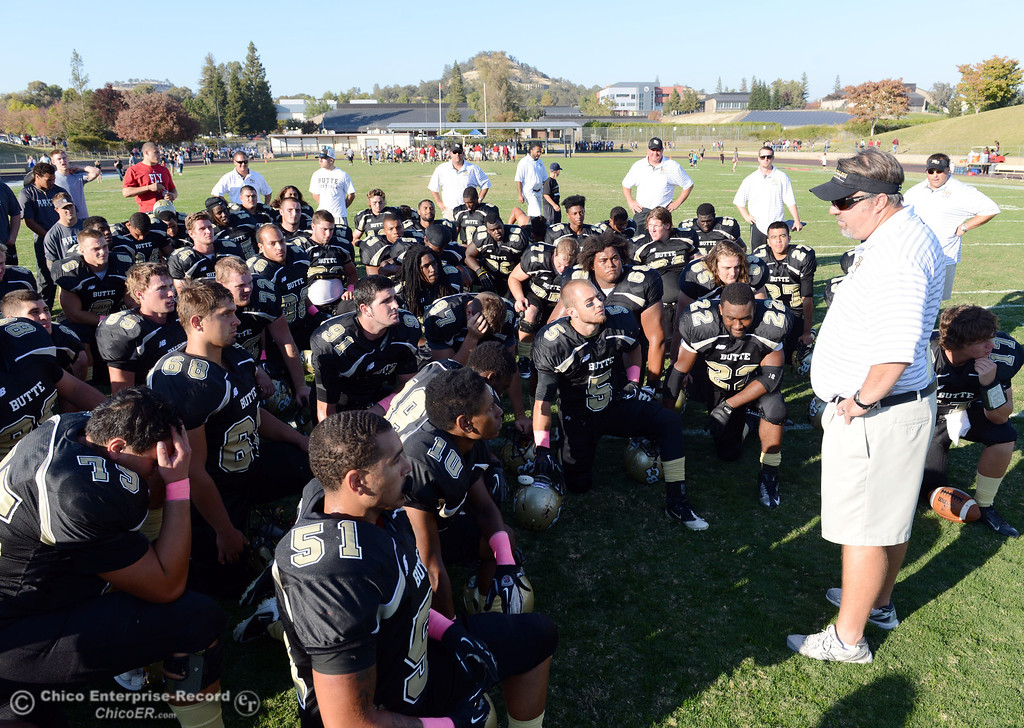 Description of . Butte College coach Jeff Jordan (right) talks to the team against De Anza College in the fourth quarter of their football game at Butte's Cowan Stadium Saturday, October 26, 2013 in Oroville, Calif.  (Jason Halley/Chico Enterprise-Record)