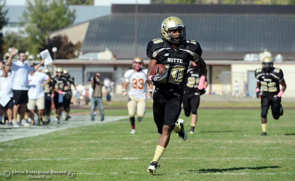 Description of . Butte College's #10 CJ Grice carries a kick return for a touchdown against De Anza College in the second quarter of their football game at Butte's Cowan Stadium Saturday, October 26, 2013 in Oroville, Calif.  (Jason Halley/Chico Enterprise-Record)