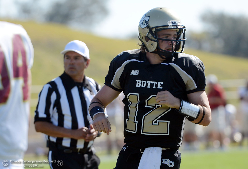 Description of . Butte College's #12 Thomas Stuart scored a touchdown against De Anza College in the first quarter of their football game at Butte's Cowan Stadium Saturday, October 26, 2013 in Oroville, Calif.  (Jason Halley/Chico Enterprise-Record)