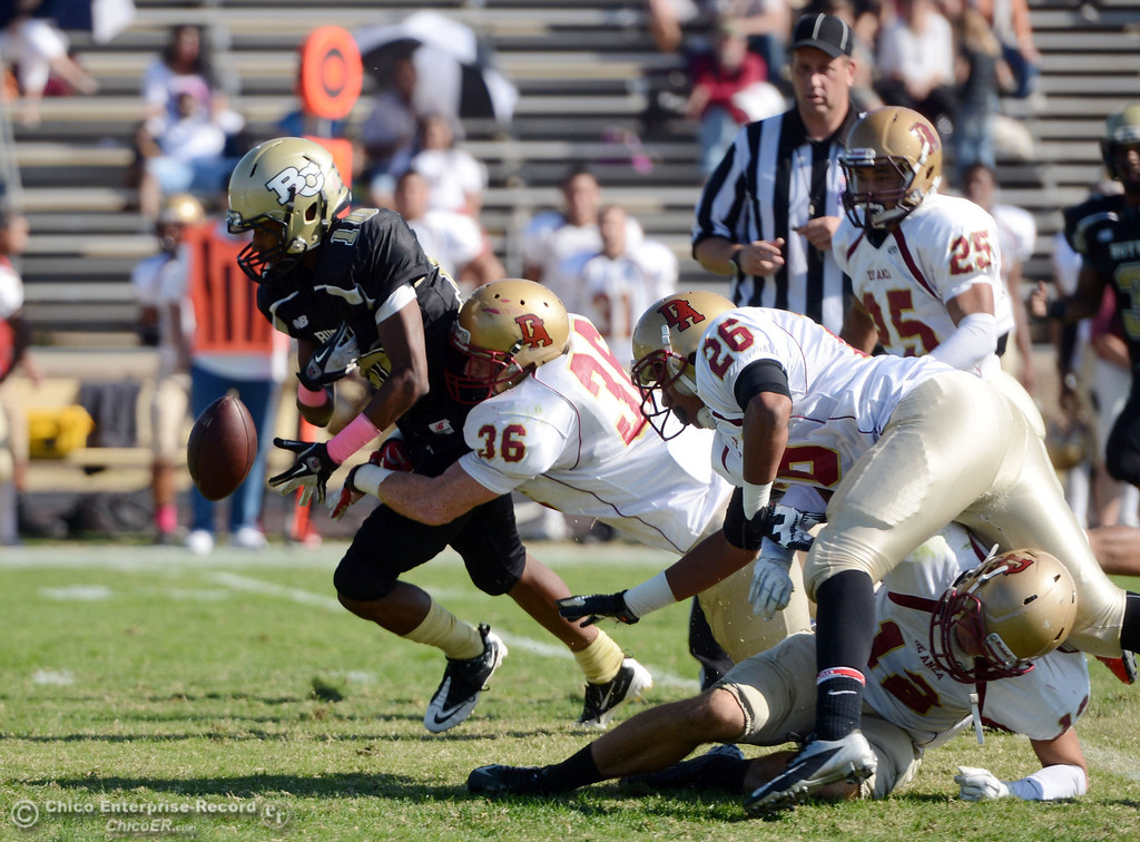 Description of . Butte College's #10 CJ Grice (left) fumbles a punt return against De Anza College's #36 Brandon Martinez (right) in the first quarter of their football game at Butte's Cowan Stadium Saturday, October 26, 2013 in Oroville, Calif.  (Jason Halley/Chico Enterprise-Record)