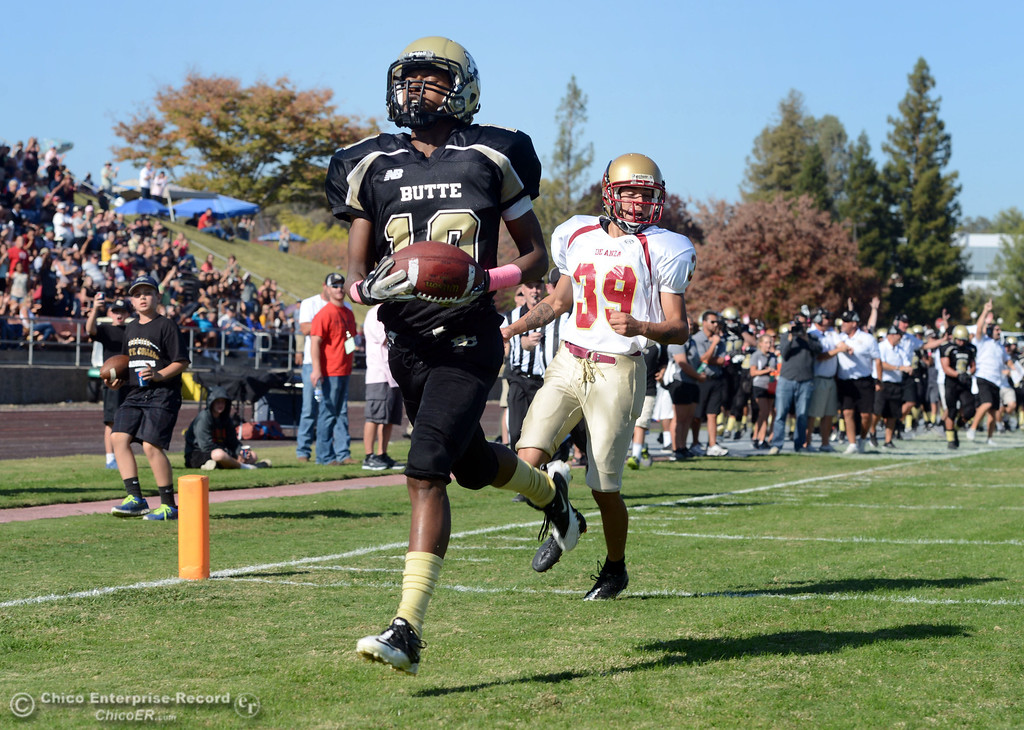 Description of . Butte College\'s #10 CJ Grice (left) walks into the end zone with a touchdown against De Anza College\'s #39 Michael Brown (right) in the second quarter of their football game at Butte\'s Cowan Stadium Saturday, October 26, 2013 in Oroville, Calif.  (Jason Halley/Chico Enterprise-Record)