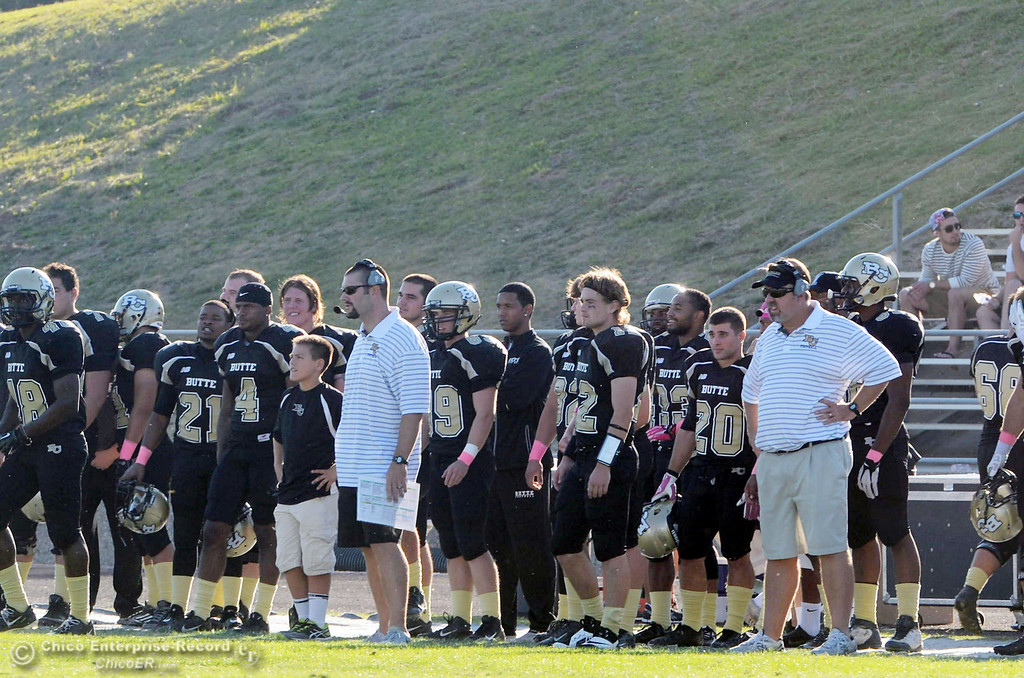 Description of . Butte College coaches Rob Snelling (left) and Jeff Jordan (right) against De Anza College in the fourth quarter of their football game at Butte\'s Cowan Stadium Saturday, October 26, 2013 in Oroville, Calif.  (Jason Halley/Chico Enterprise-Record)