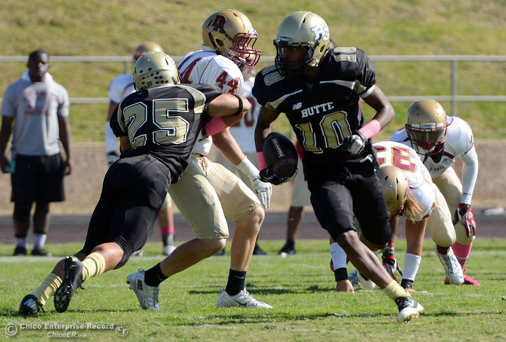 Description of . Butte College's #10 CJ Grice rushes against De Anza College in the first quarter of their football game at Butte's Cowan Stadium Saturday, October 26, 2013 in Oroville, Calif.  (Jason Halley/Chico Enterprise-Record)