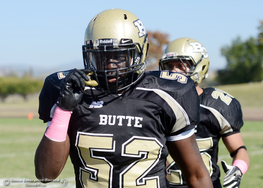 Description of . Butte College\'s #52 Kyjuan Tate looks on against De Anza College in the second quarter of their football game at Butte\'s Cowan Stadium Saturday, October 26, 2013 in Oroville, Calif.  (Jason Halley/Chico Enterprise-Record)