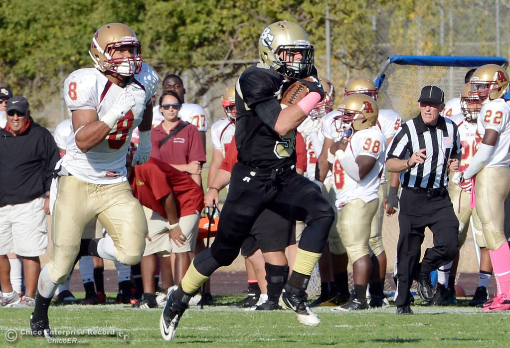 Description of . Butte College\'s #5 David Brannon (right) rushes for a touchdown against De Anza College\'s #8 Josh McCain (left) in the third quarter of their football game at Butte\'s Cowan Stadium Saturday, October 26, 2013 in Oroville, Calif.  (Jason Halley/Chico Enterprise-Record)