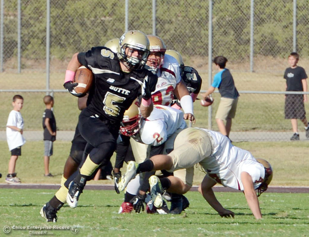 Description of . Butte College's #5 David Brannon (center) rushes for a touchdown against De Anza College in the third quarter of their football game at Butte's Cowan Stadium Saturday, October 26, 2013 in Oroville, Calif.  (Jason Halley/Chico Enterprise-Record)