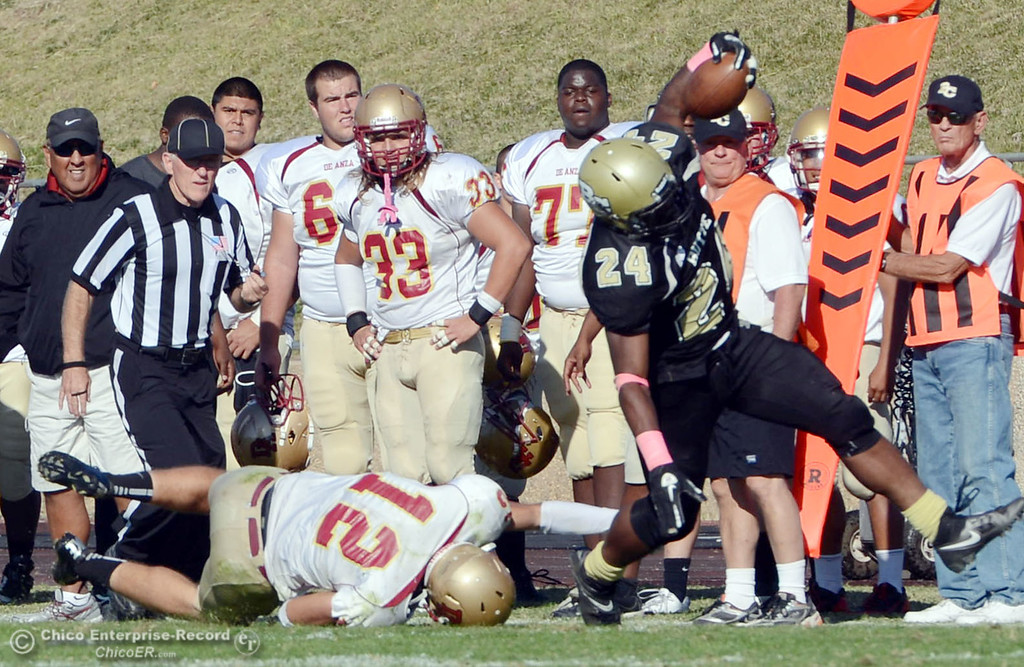 Description of . Butte College's #24 Kendall Williams (right) breaks a tackle against De Anza College's #12 Rodney McKenzie (left) in the third quarter of their football game at Butte's Cowan Stadium Saturday, October 26, 2013 in Oroville, Calif.  (Jason Halley/Chico Enterprise-Record)