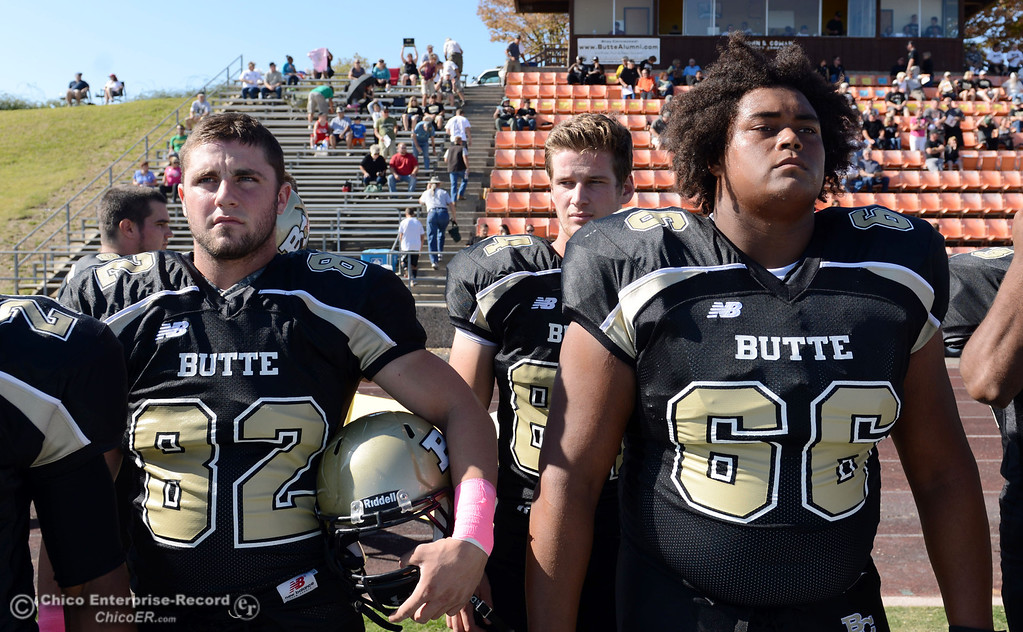 Description of . Butte College's #82 Greg Cannon (left) and #66 aul Tablit III (right) against De Anza College in the first quarter of their football game at Butte's Cowan Stadium Saturday, October 26, 2013 in Oroville, Calif.  (Jason Halley/Chico Enterprise-Record)