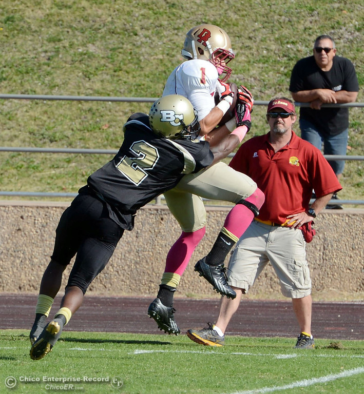 Description of . Butte College\'s #2 Deonte Flemings (left) tackles against De Anza College\'s #1 Bryan Fobbs (right) in the second quarter of their football game at Butte\'s Cowan Stadium Saturday, October 26, 2013 in Oroville, Calif.  (Jason Halley/Chico Enterprise-Record)