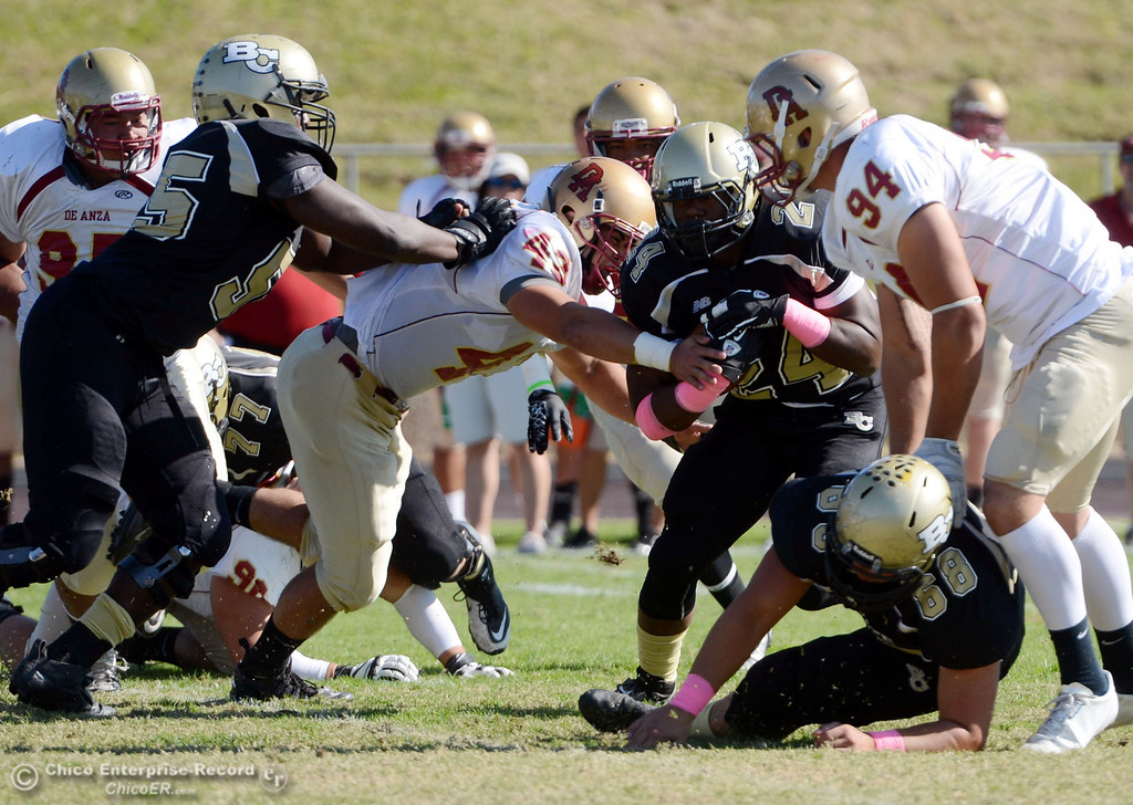 Description of . Butte College against De Anza College in the first quarter of their football game at Butte\'s Cowan Stadium Saturday, October 26, 2013 in Oroville, Calif.  (Jason Halley/Chico Enterprise-Record)
