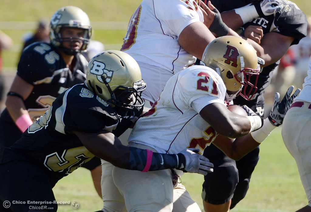 Description of . Butte College\'s #58 Sie Doe Jr. (left) tackles against De Anza College\'s #21 Kaelum Harvey (right) in the first quarter of their football game at Butte\'s Cowan Stadium Saturday, October 26, 2013 in Oroville, Calif.  (Jason Halley/Chico Enterprise-Record)