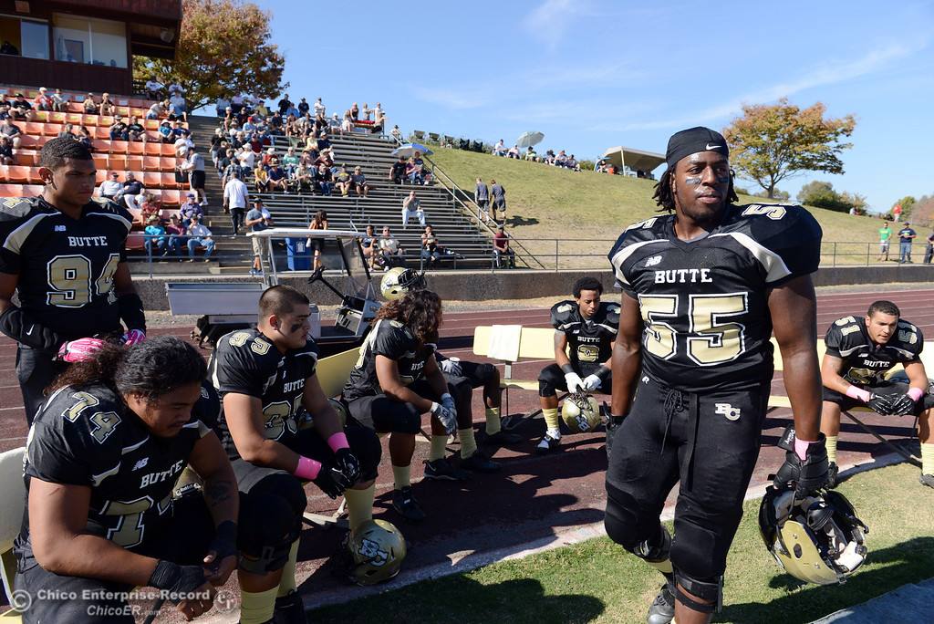 Description of . Butte College's #55 Dominique Harris (right) looks on against De Anza College in the first quarter of their football game at Butte's Cowan Stadium Saturday, October 26, 2013 in Oroville, Calif.  (Jason Halley/Chico Enterprise-Record)