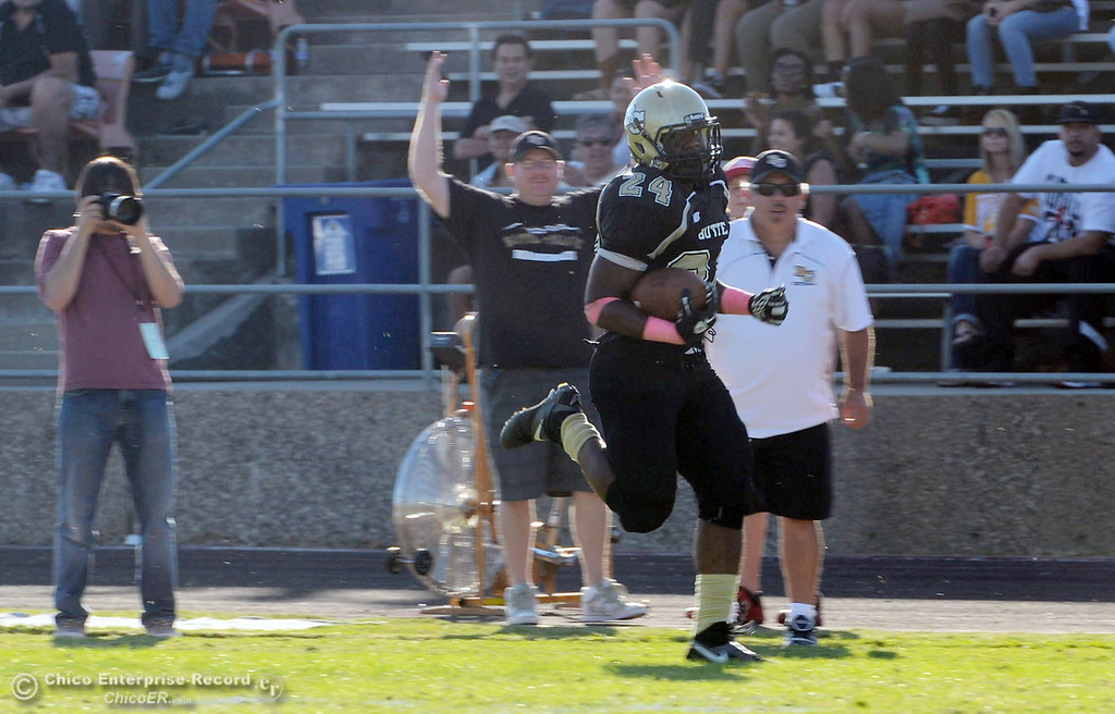 Description of . Butte College\'s #24 Kendall Williams rushes for a touchdown against De Anza College in the fourth quarter of their football game at Butte\'s Cowan Stadium Saturday, October 26, 2013 in Oroville, Calif.  (Jason Halley/Chico Enterprise-Record)