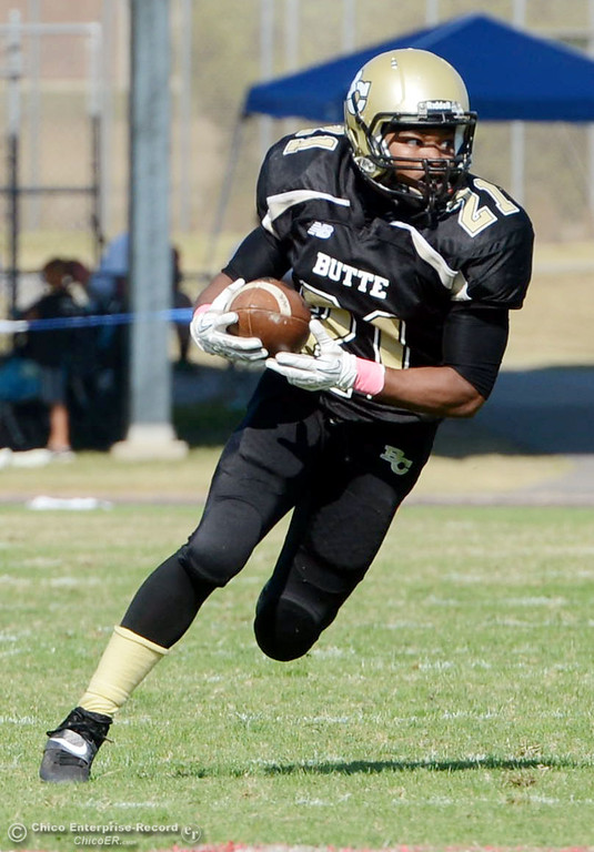 Description of . Butte College\'s #21 Marvel Harris rushes against De Anza College in the second quarter of their football game at Butte\'s Cowan Stadium Saturday, October 26, 2013 in Oroville, Calif.  (Jason Halley/Chico Enterprise-Record)