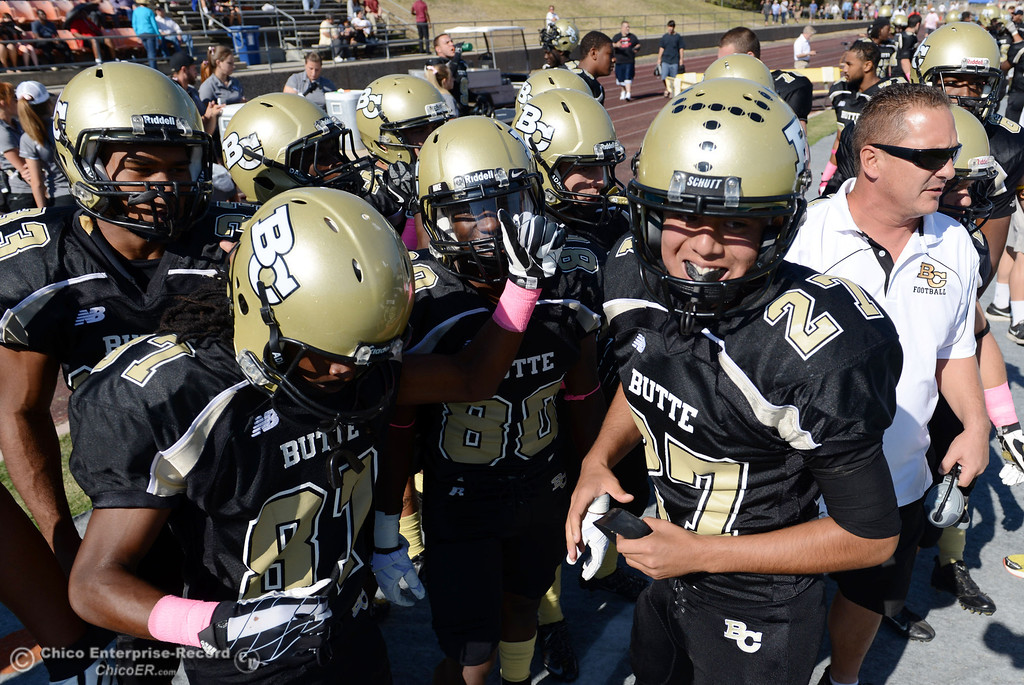 Description of . Butte College's #33 Jariah Booker, #87 Timazray Shepherd, #80 Jerome Mayfield, #27 Rigoberto Sanchez and coach Tim Garcia (left to right) ready against De Anza College in the first quarter of their football game at Butte's Cowan Stadium Saturday, October 26, 2013 in Oroville, Calif.  (Jason Halley/Chico Enterprise-Record)