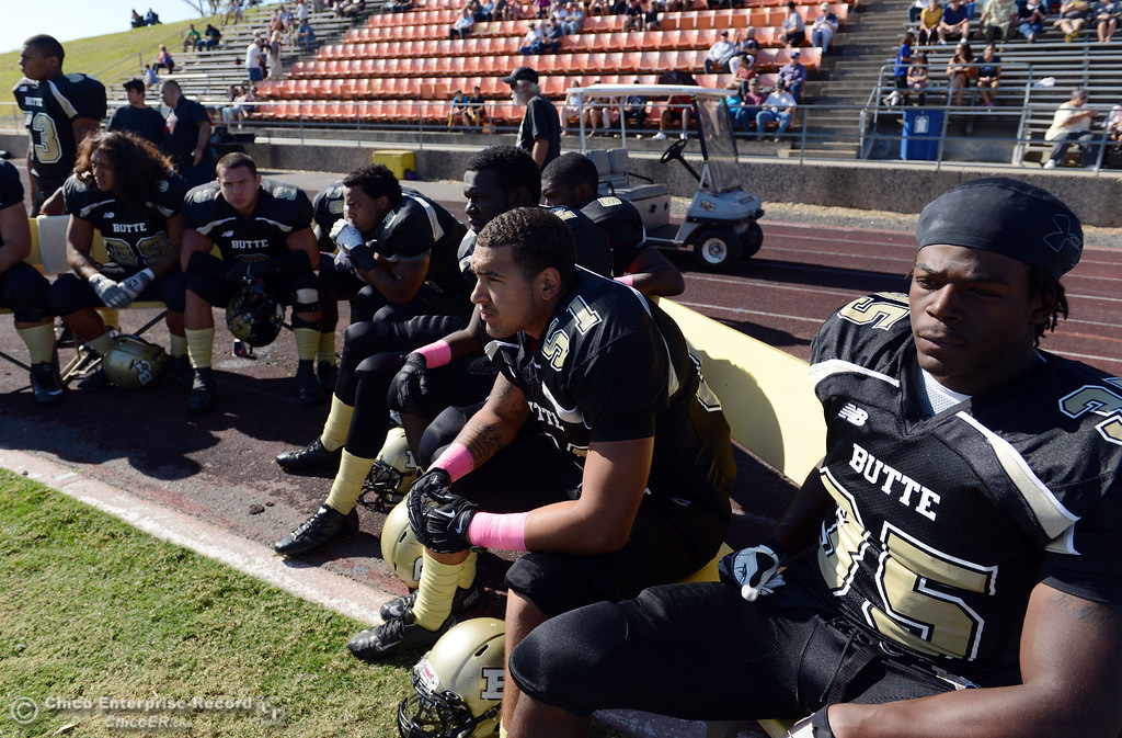 Description of . Butte College's #51 Izaya Johnson (center) and #35 Zach Williams (right) look on against De Anza College in the first quarter of their football game at Butte's Cowan Stadium Saturday, October 26, 2013 in Oroville, Calif.  (Jason Halley/Chico Enterprise-Record)