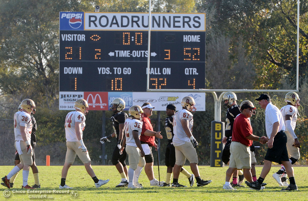 Description of . Butte College against De Anza College at the end of the fourth quarter of their football game at Butte's Cowan Stadium Saturday, October 26, 2013 in Oroville, Calif.  (Jason Halley/Chico Enterprise-Record)