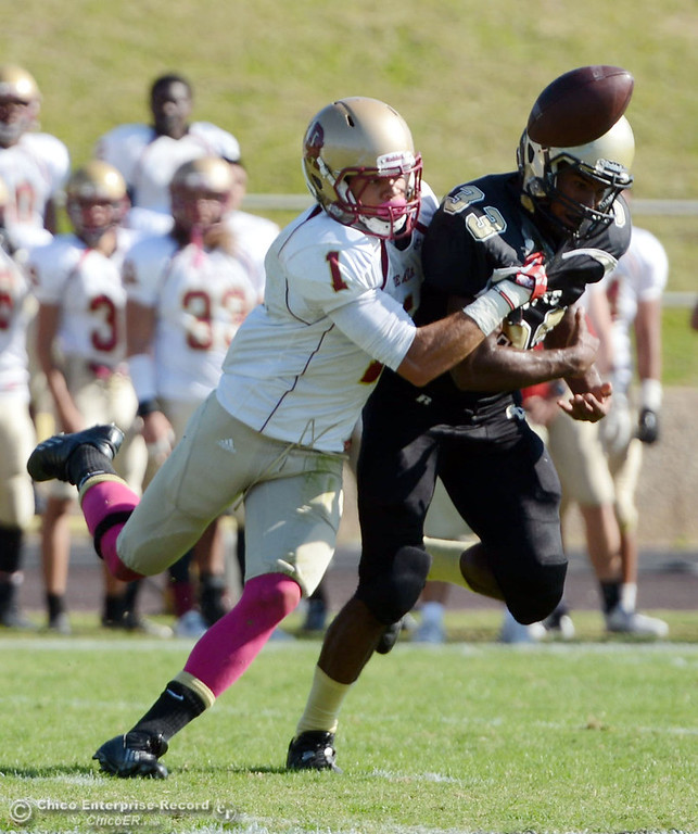 Description of . Butte College's #33 Jariah Booker (right) breaks up a pass against De Anza College's #1 Bryan Fobbs (left) in the second quarter of their football game at Butte's Cowan Stadium Saturday, October 26, 2013 in Oroville, Calif.  (Jason Halley/Chico Enterprise-Record)