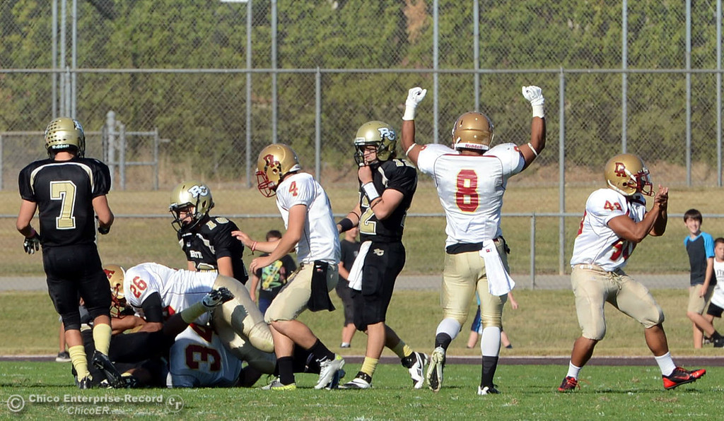 Description of . De Anza College recover an onside kick return against Butte College in the third quarter of their football game at Butte\'s Cowan Stadium Saturday, October 26, 2013 in Oroville, Calif.  (Jason Halley/Chico Enterprise-Record)