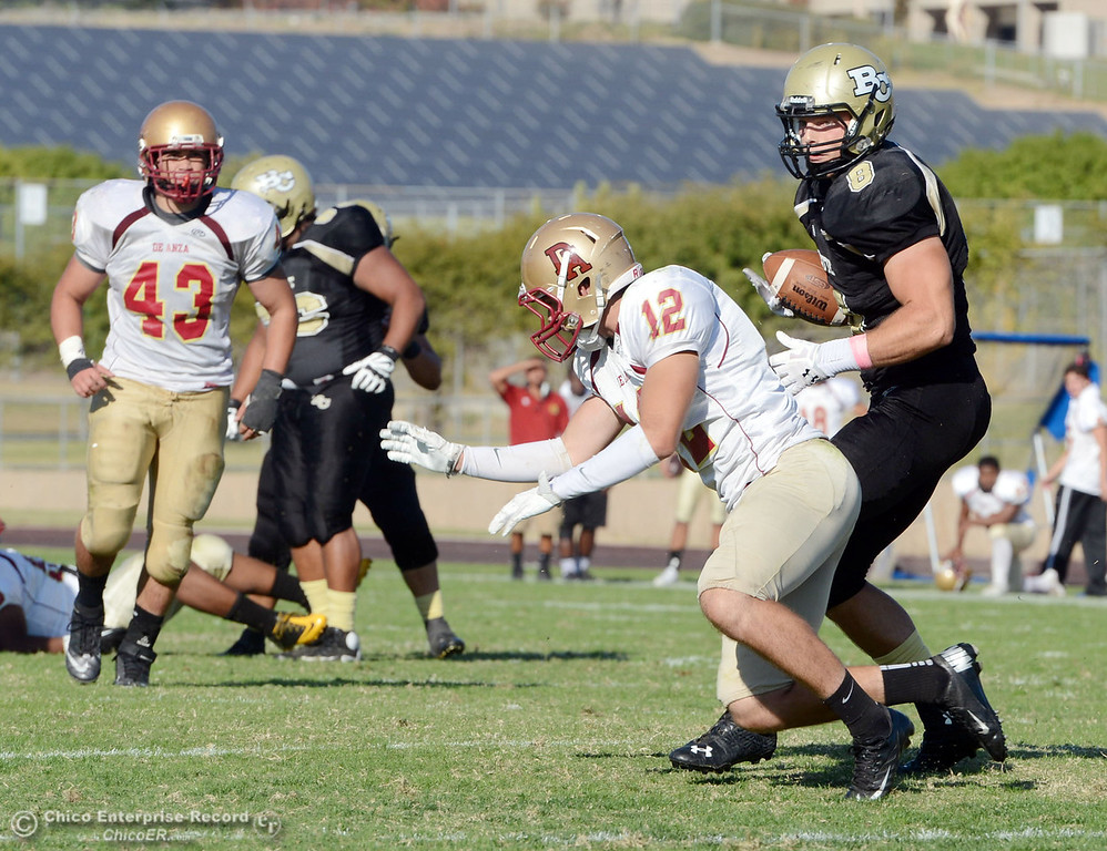 Description of . Butte College's #8 Bo Brummel (right) breaks a tackle to score a touchdown against De Anza College's #12 Rodney McKenzie (left) in the third quarter of their football game at Butte's Cowan Stadium Saturday, October 26, 2013 in Oroville, Calif.  (Jason Halley/Chico Enterprise-Record)