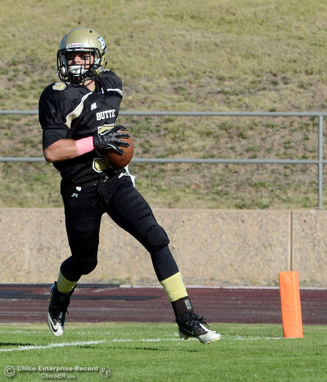 Description of . Butte College\'s #5 David Brannon rushes for a touchdown against De Anza College in the third quarter of their football game at Butte\'s Cowan Stadium Saturday, October 26, 2013 in Oroville, Calif.  (Jason Halley/Chico Enterprise-Record)