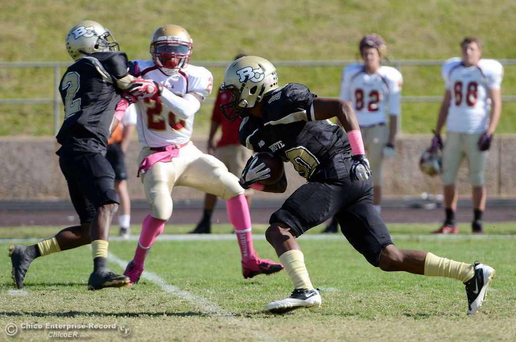 Description of . Butte College\'s #10 CJ Grice carries a punt return against De Anza College in the first quarter of their football game at Butte\'s Cowan Stadium Saturday, October 26, 2013 in Oroville, Calif.  (Jason Halley/Chico Enterprise-Record)