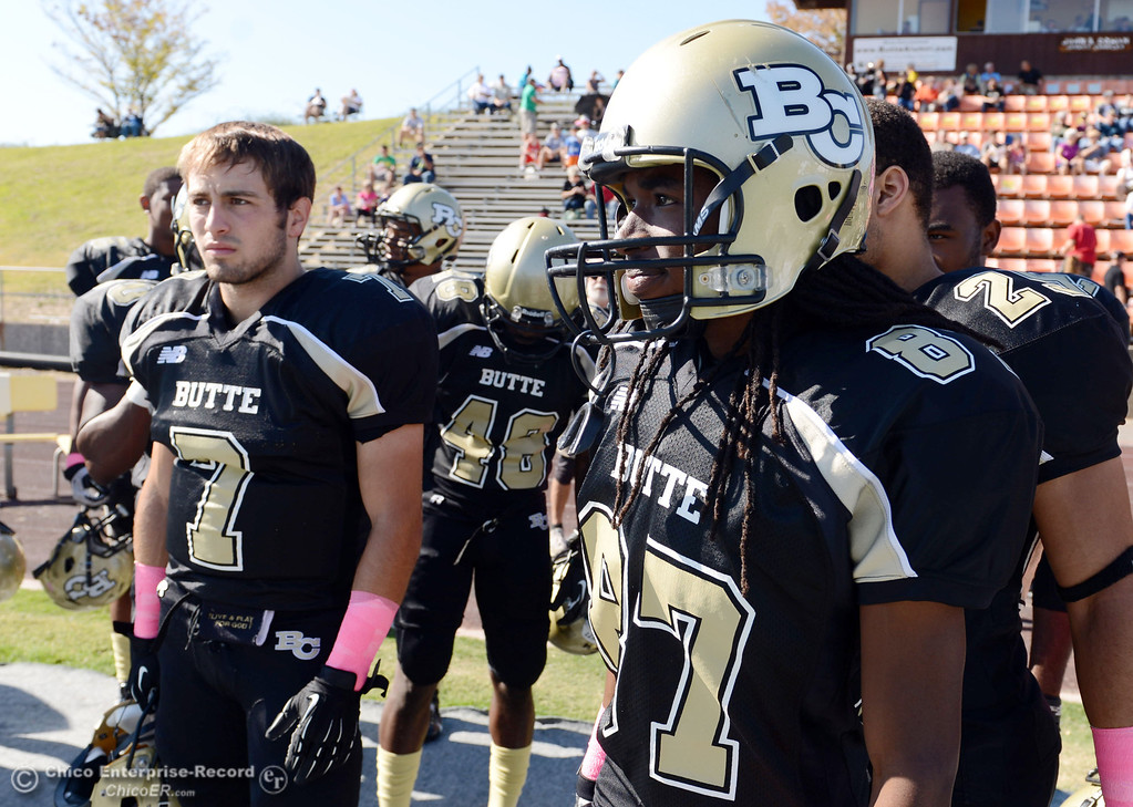 Description of . Butte College's #7 Ryan Holland (left) and #87 Timazray Shepherd (right) look on against De Anza College in the first quarter of their football game at Butte's Cowan Stadium Saturday, October 26, 2013 in Oroville, Calif.  (Jason Halley/Chico Enterprise-Record)