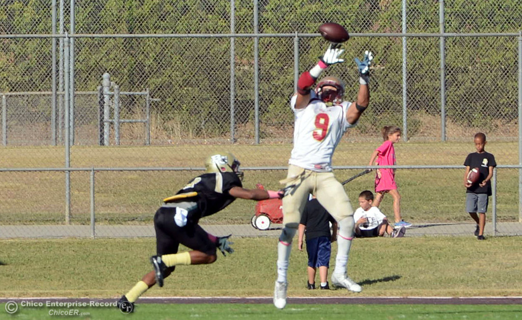 Description of . De Anza College's #9 Justin Arcune (right) catches for a touchdown against Butte College in the third quarter of their football game at Butte's Cowan Stadium Saturday, October 26, 2013 in Oroville, Calif.  (Jason Halley/Chico Enterprise-Record)