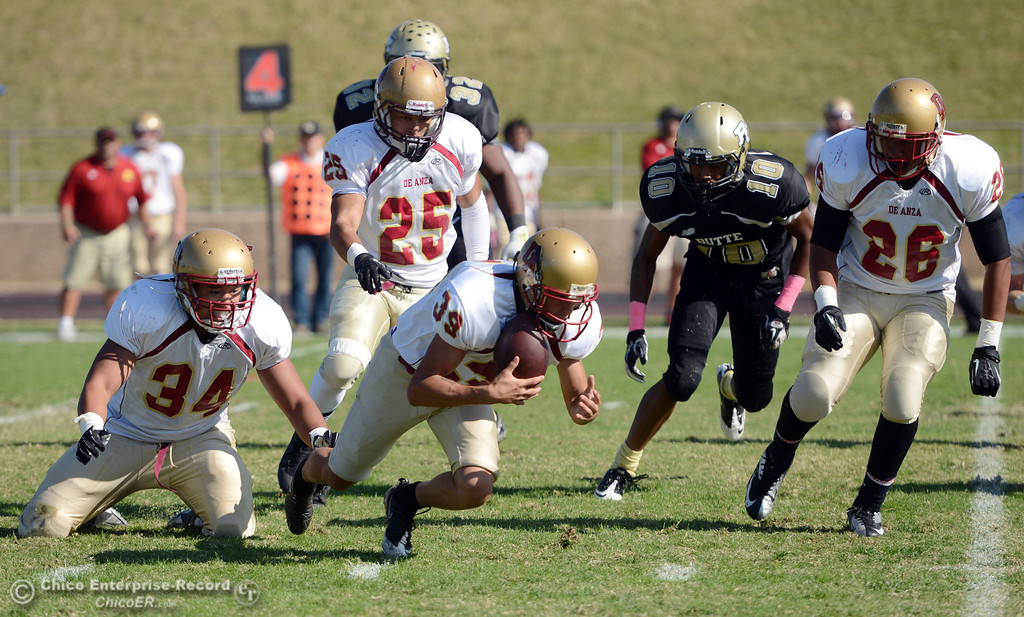 Description of . Butte College\'s #10 CJ Grice (right) fumbled a punt return picked up by De Anza College\'s #39 Michael Brown (center) alongside #34 Phillip Watkins, #25 Chris Carrillo ,and # 26 Trevor Pardula (left to right) in the first quarter of their football game at Butte\'s Cowan Stadium Saturday, October 26, 2013 in Oroville, Calif.  (Jason Halley/Chico Enterprise-Record)