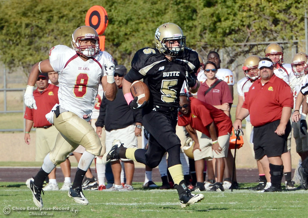 Description of . Butte College's #5 David Brannon (right) rushes for a touchdown against De Anza College's #8 Josh McCain (left) in the third quarter of their football game at Butte's Cowan Stadium Saturday, October 26, 2013 in Oroville, Calif.  (Jason Halley/Chico Enterprise-Record)