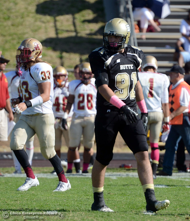 Description of . Butte College\'s #91 Mike Fratianni against De Anza College in the first quarter of their football game at Butte\'s Cowan Stadium Saturday, October 26, 2013 in Oroville, Calif.  (Jason Halley/Chico Enterprise-Record)