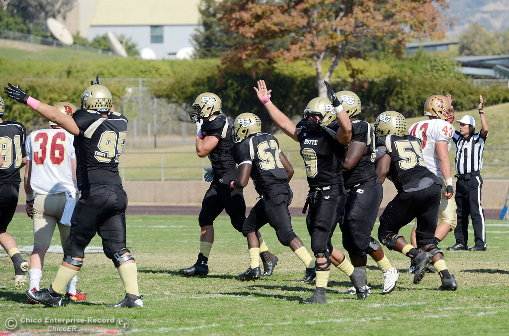 Description of . Butte College reacts to a field goal that was good against De Anza College in the second quarter of their football game at Butte's Cowan Stadium Saturday, October 26, 2013 in Oroville, Calif.  (Jason Halley/Chico Enterprise-Record)