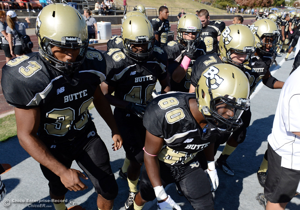 Description of . Butte College's #33 Jariah Booker (left) #48 Michael Faggett, (center) and #87 Timazray Shepherd (right) ready against De Anza College in the first quarter of their football game at Butte's Cowan Stadium Saturday, October 26, 2013 in Oroville, Calif.  (Jason Halley/Chico Enterprise-Record)