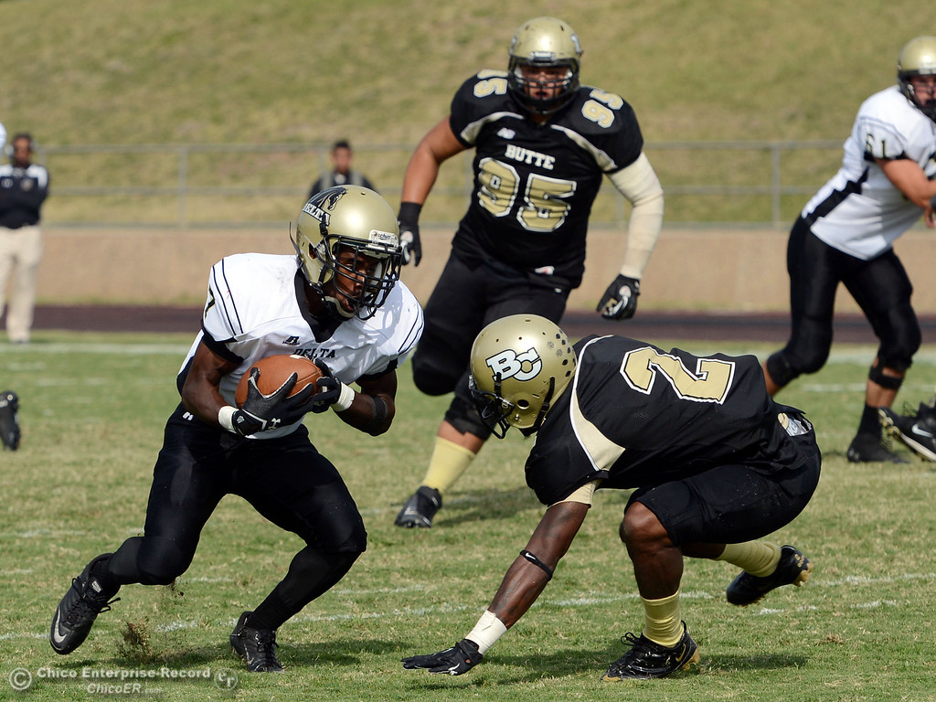 . Butte College\'s #95 Mark Rosenquist (back) watches #2 Deonte Flemings (right) tackle against Delta College\'s #7 TJ Brown (left) in the fourth quarter of their football game at Butte\'s Cowan Stadium Saturday, September 28, 2013, in Oroville, Calif.  (Jason Halley/Chico Enterprise-Record)