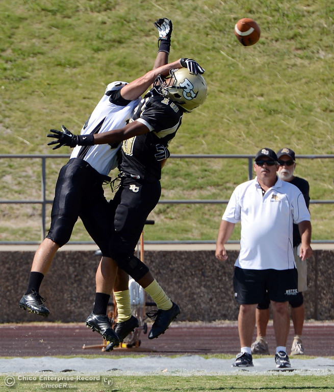 Description of . Butte College's #10 CJ Grice (right) has a pass broken up by Delta College's #3 SynJohn Sears (left) in the first quarter of their football game at Butte's Cowan Stadium Saturday, September 28, 2013, in Oroville, Calif.  (Jason Halley/Chico Enterprise-Record)