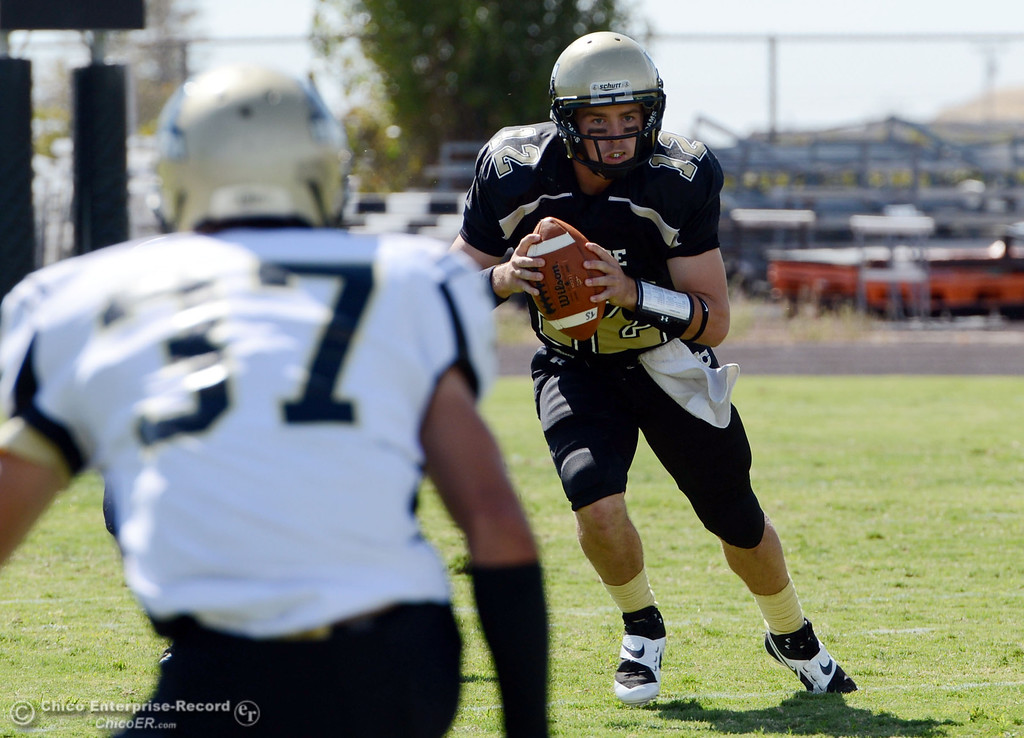 Description of . Butte College\'s #12 Thomas Stuart (right) scrambles against Delta College in the first quarter of their football game at Butte\'s Cowan Stadium Saturday, September 28, 2013, in Oroville, Calif.  (Jason Halley/Chico Enterprise-Record)
