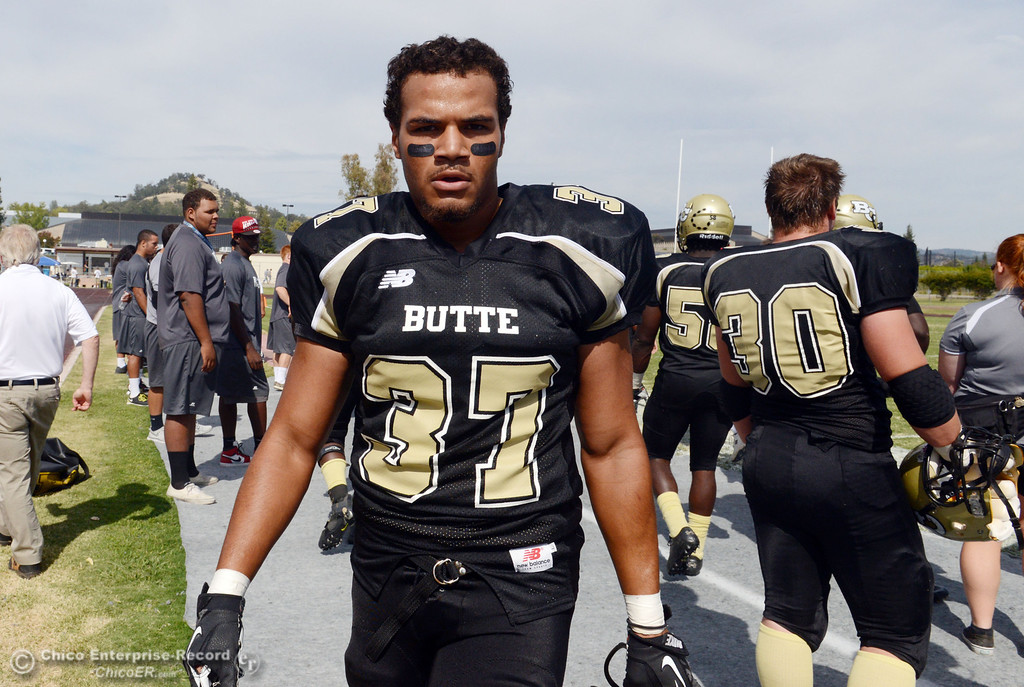 Description of . Butte College's #37 Demetre Lopez looks on against Delta College in the second quarter of their football game at Butte's Cowan Stadium Saturday, September 28, 2013, in Oroville, Calif.  (Jason Halley/Chico Enterprise-Record)