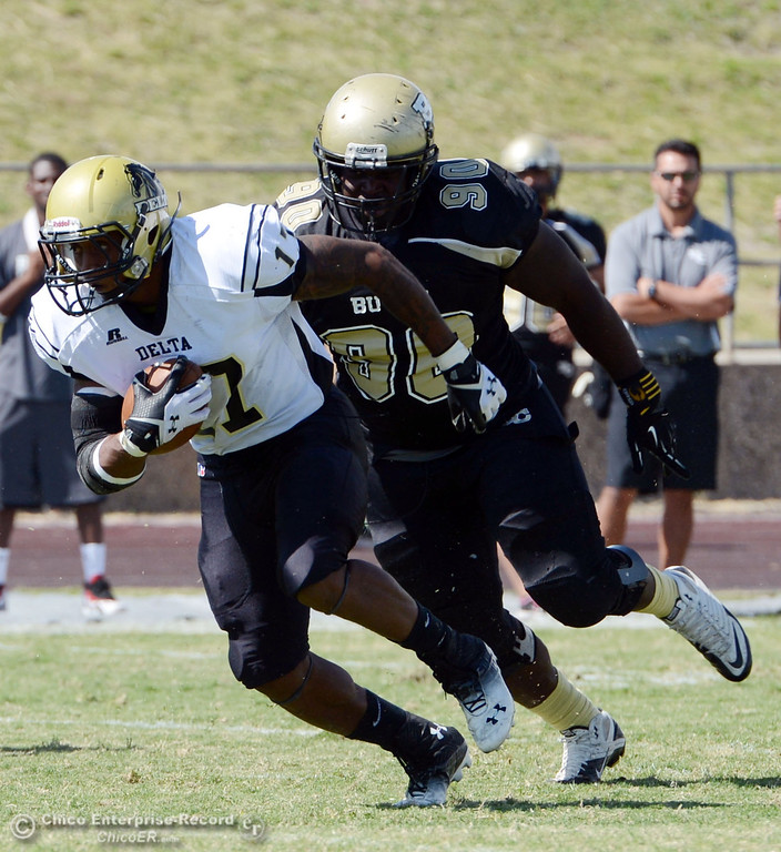 Description of . Delta College\' s#17 Theo Wofford (left) rushes against Butte College\'s #90 Stephen Francios (right) in the first quarter of their football game at Butte\'s Cowan Stadium Saturday, September 28, 2013, in Oroville, Calif.  (Jason Halley/Chico Enterprise-Record)
