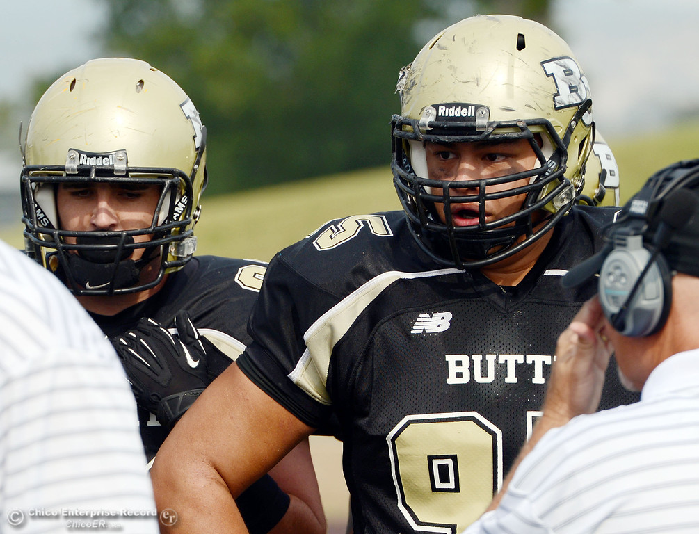 . Butte College\'s #95 Mark Rosenquist (Right) looks on against Delta College in the fourth quarter of their football game at Butte\'s Cowan Stadium Saturday, September 28, 2013, in Oroville, Calif.  (Jason Halley/Chico Enterprise-Record)