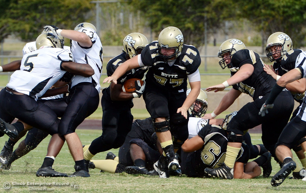 Description of . Butte College\'s #77 Scott Batchelder (center) against Delta College in the second quarter of their football game at Butte\'s Cowan Stadium Saturday, September 28, 2013, in Oroville, Calif.  (Jason Halley/Chico Enterprise-Record)