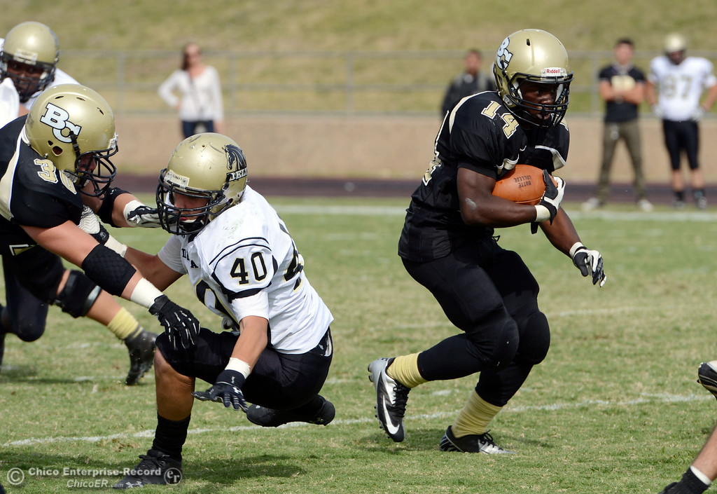 Description of . Butte College\'s #14 Robert Frazier rushes against Delta College in the third quarter of their football game at Butte\'s Cowan Stadium Saturday, September 28, 2013, in Oroville, Calif.  (Jason Halley/Chico Enterprise-Record)